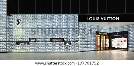 SHANGHAI-JUNE 4, 2014. Louis Vuitton outlet at Lujiazui. Despite Chinaâ��s luxury slowdown LVMH Mo�«t Hennessy Louis Vuitton, the worldâ��s largest luxury conglomerate, saw 8 percent China growth in 2013. - stock photo