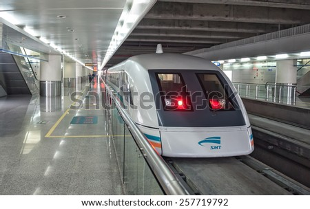 SHANGHAI - JUNE 1: Maglev train starts operation on June 1, 2010 in Shanghai, China. This train is the first commercially operated high-speed magnetic levitation line in the world (speed: 500 km/h) - stock photo