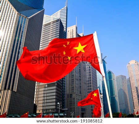 Shanghai Lujiazui civic landscape of China national flags - stock photo