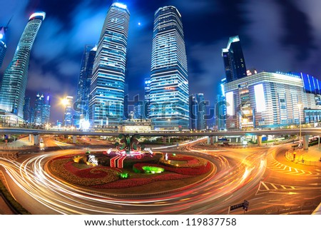 shanghai lujiazui downtown at night with light trails on the roundabout