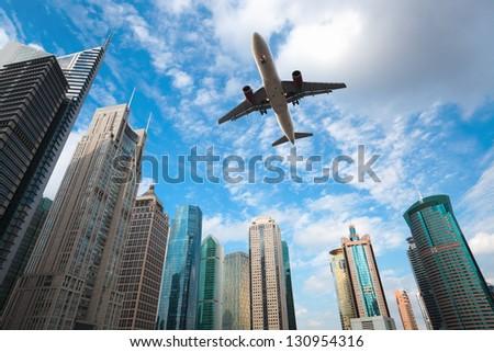 shanghai lujiazui financial center skyline with airplane - stock photo