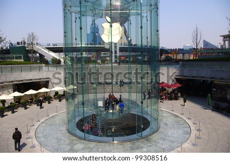 SHANGHAI-March 24: View of the Apple store on March 24, 2012 in Shanghai, Pudong District. This is China's second Apple the store opened on July 10, 2010. - stock photo