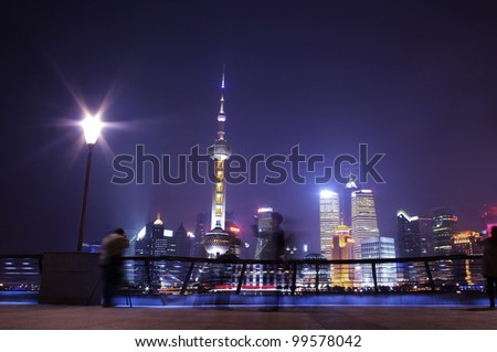 Shanghai night skyline and visitors - stock photo
