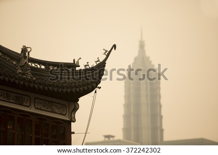 Shanghai old building at Yuyuan,also named as Yu Garden.The background is the Finance building at Pudong (East Shanghai) area,China - stock photo