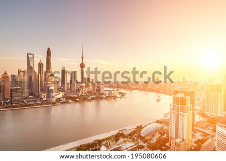 shanghai skyline and huangpu river with sunset glow