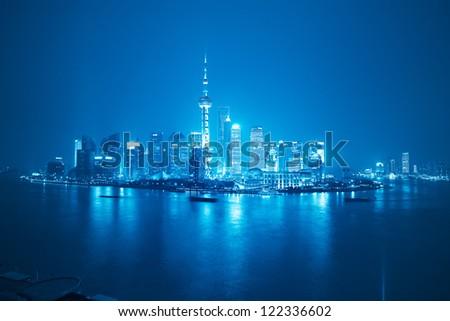 shanghai skyline at night with blue tone - stock photo