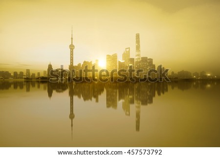 Shanghai skyline in the morning with reflection, Shanghai China huangpu river with sunset glow
