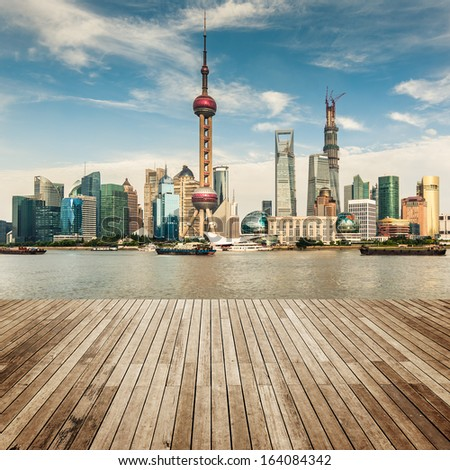 shanghai skyline with reflection,China - stock photo