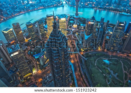 Shanghai Skyscraper at night, aerial view of high-rise buildings  in Pudong,Shanghai, China. Jin Mao Tower (one of China's tallest buildings) and Oriental Pearl Tower. - stock photo