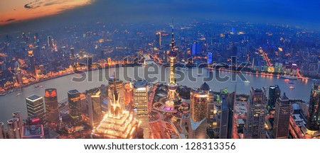 Shanghai sunset aerial view with urban architecture and river - stock photo