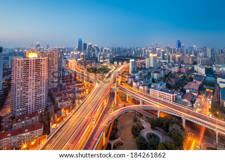 shanghai traffic at night , interchange overpass and elevated road with modern city skyline - stock photo