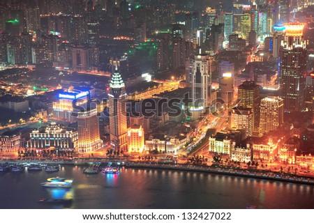 Shanghai urban architecture over Huangpu River at night - stock photo