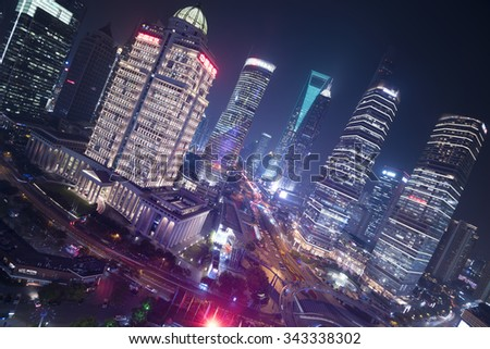 Shanghail, China - Oct 12, 2015: Elevated night view of  Lujiazui district in Shanghai. Lujiazui has been developed specifically as a new financial district of Shanghai.  - stock photo
