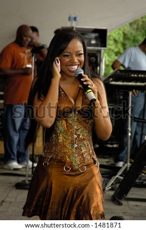 Shanice with cell phone and microphone