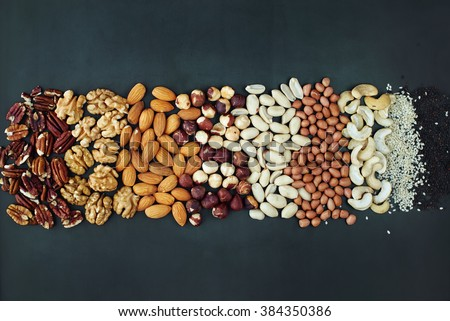 Shape Line Peanut Almond Cashew Walnut Hazel Nut Pecan Sesame Black Wooden Background Top view Healthy Concept - stock photo