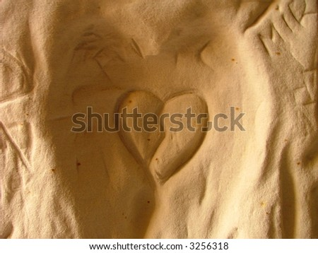 shape of an heart scraped into the cave's wall - stock photo