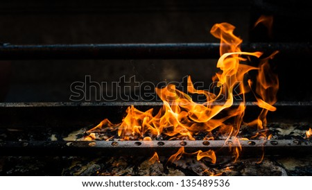 shape of fire burning paper on grill - stock photo