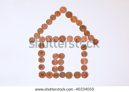 shape of house made out of cents and pennies