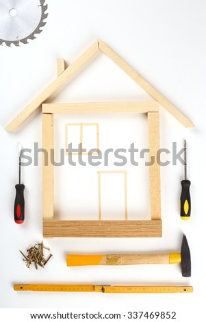 shape of house made out of tools over white - stock photo