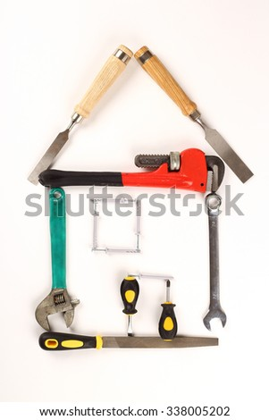shape of house made out of tools over white