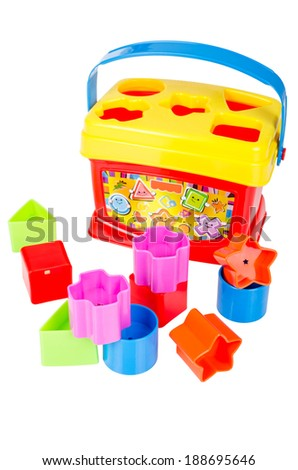 Shape sorter toy with various colored blocks isolated on white background - stock photo