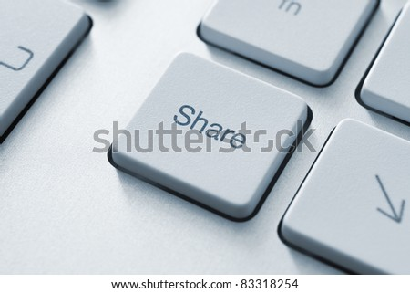 Share button on the keyboard. Toned Image. - stock photo