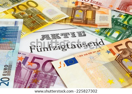 Share outlined with Euro banknotes - stock photo