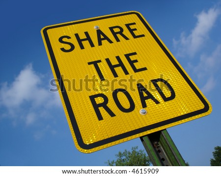 Share the road sign. - stock photo