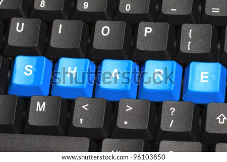 Share word on blue and black keyboard button - stock photo