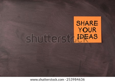 Share your ideas note pasted on blackboard which can be your background for your edit. - stock photo