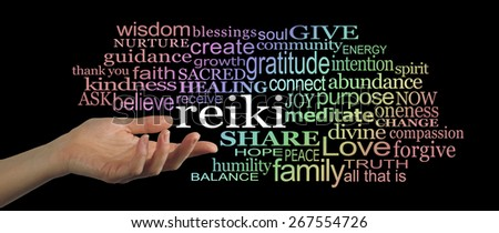 Sharing Reiki Word Cloud Banner    Female hand facing upwards gesturing towards the word 'reiki' floating off with a word cloud of healing words graduated with rainbow coloring on a black background - stock photo