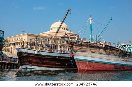 SHARJAH, UAE - OCTOBER 29: Sharjah port, on October 29, 2013. Sharjah is located along northern coast of Persian Gulf on Arabian Peninsula - stock photo