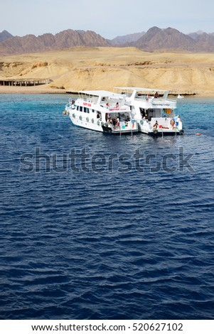 SHARM EL SHEIKH, EGYPT -  DECEMBER 4: Snorkeling tourists and motor yachts on Red Sea in Ras Muhammad National Park. It is popular tourists destination on December 4, 2013 in Sharm el Sheikh, Egypt