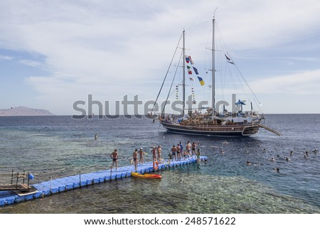 Sharm el-Sheikh, Egypt - December 2, 2014: The sailing ship with tourists onboard goes to the Red Sea