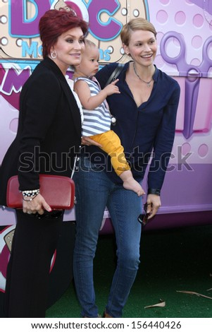 "Sharon Osbourne, Lisa Stelly and Pearl Osbourne at Disney Junior's ""Doc McStuffins"" Host ""Doc Mobile"" Tour, The Grove, Los Angeles, CA 09-26-13 - stock photo"