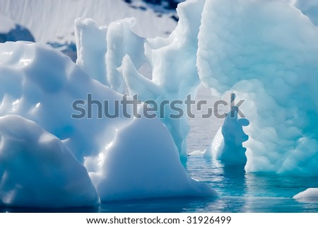 sharp and soft cyan icebergs - stock photo