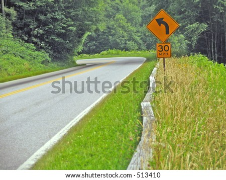 sharp curve ahead - stock photo