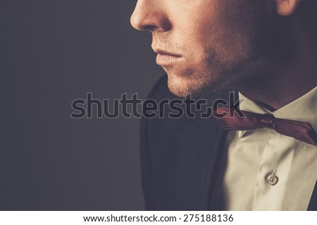 Sharp dressed man wearing jacket and bow tie - stock photo