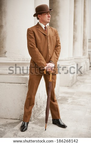 Sharp Dresser In Brown Suit And Matching Bowler Hat - stock photo