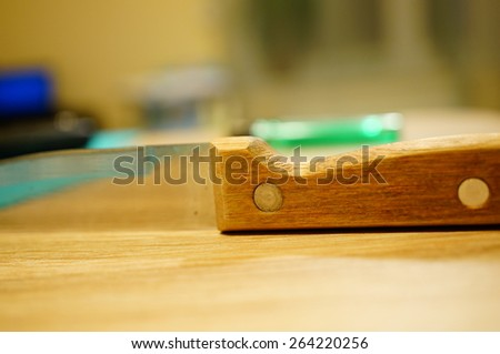 Sharp kitchen knife lying on table