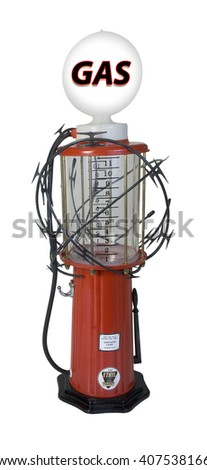 Sharp razor wired used as a barrier wrapped around a gas pump - path included - stock photo