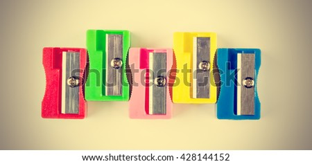 Sharpener colors in vintage style. Horizontal image. - stock photo