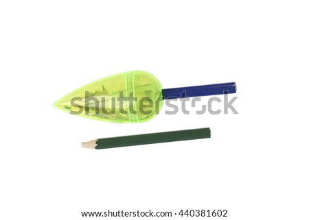 Sharpener sharpens a pencil. Isolated on white. - stock photo