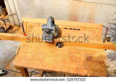 sharpener tool on a wood desk - stock photo