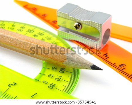 sharpener with pencil and protractor with triangle - stock photo