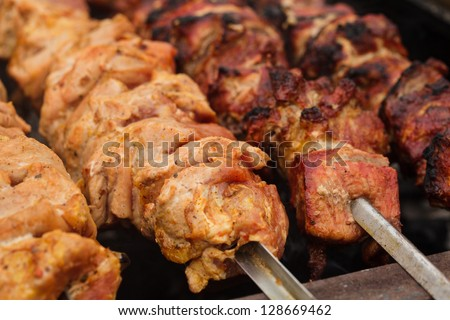 Shashlik on skewers closeup, raw and cooked - stock photo