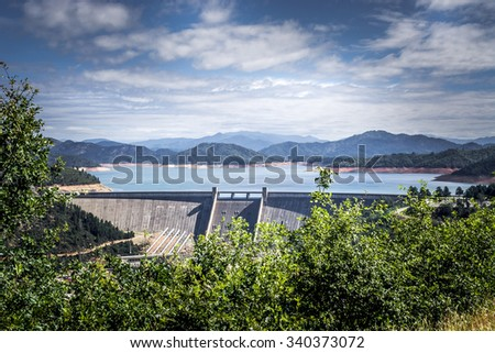 Shasta Dam is a concrete arch-gravity dam across the Sacramento River in Northern California in the United States. At 602 feet high, it is the ninth-tallest dam in the US. solution to a Flood - stock photo