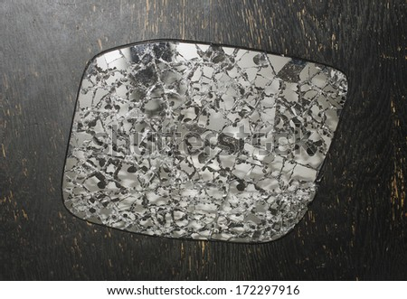 shattered broken rear view mirror - stock photo