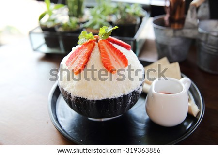Shaved ice with milk and strawberry  - stock photo
