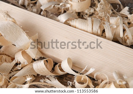 Shaving on the natural pine plank closeup - stock photo